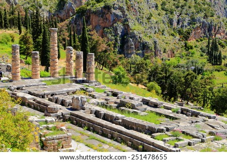 Large temple dedicated to Greek god Apollo located on green valley at Delphi, Greece - stock photo