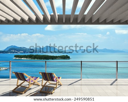 Large terrace with loungers and beautiful sea views - stock photo