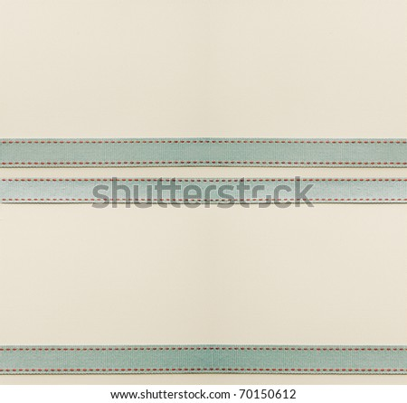 Large textured paper background with antique ribbon. - stock photo