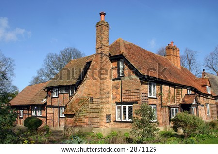 Large traditional brick and timber house in Askett, Buckinghamshire, England - stock photo