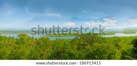 Large tropical river. Panorama. Terekhol River, North Goa, India - stock photo