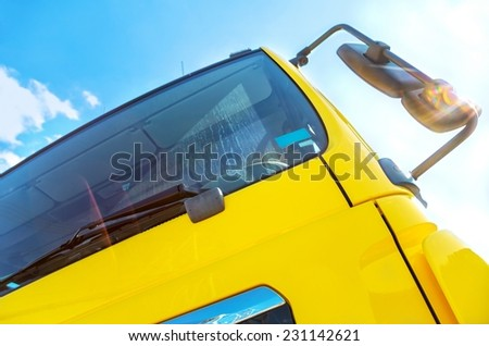Large truck details against blue sky - stock photo