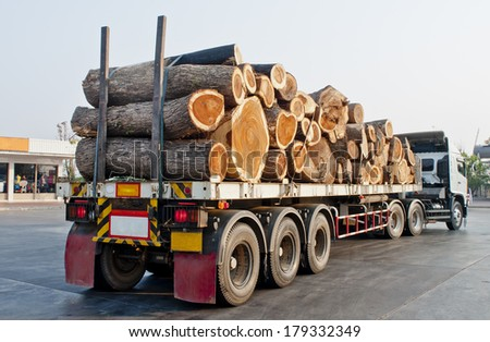 Large truck transporting wood - stock photo