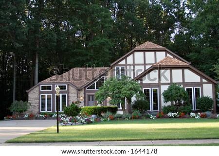 Large tudor home in suburbs. - stock photo