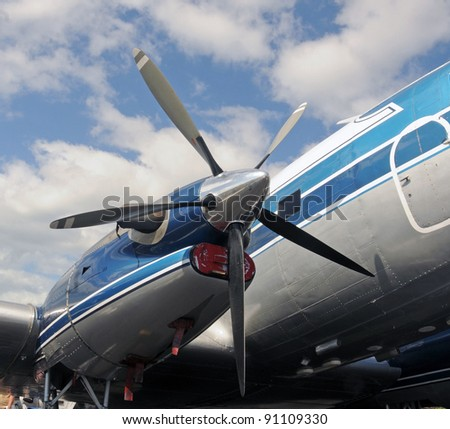 Large turboprop airplane engine and propeller - stock photo