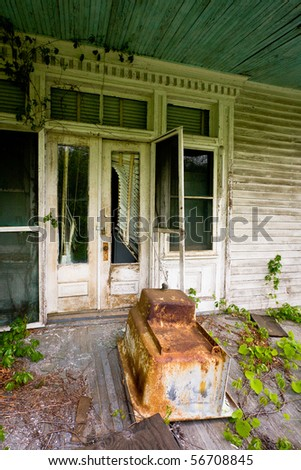 Large two story abandoned white Victorian house in Virginia mountains. - stock photo