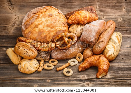 Large variety of baked goods on old wooden background