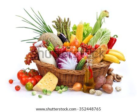 Large variety of food / studio photography of basket with foodstuff - on white background. High resolution product - stock photo