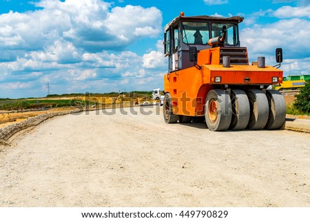 Large view on the road roller building the new road - stock photo