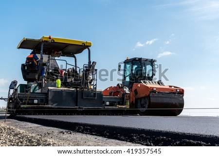 Large view on the road rollers working on the new road construction site - stock photo