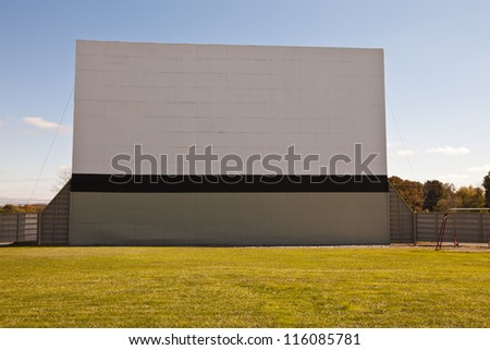 Large vintage outdoor drive-in movie theater - front view - stock photo
