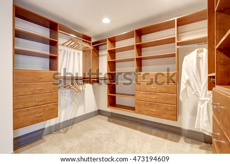 Large walk in closet with carpet floor, also including many shelves and drawers. Northwest, USA