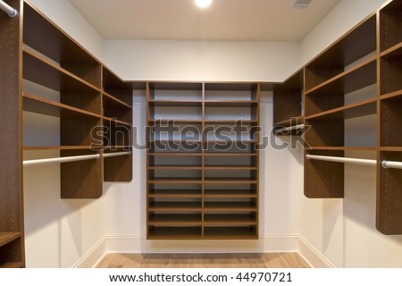 large walk in closet with modular shelves - stock photo