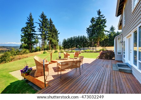 Large walkout deck with wicker furniture and perfect  landscape view. Northwest, USA