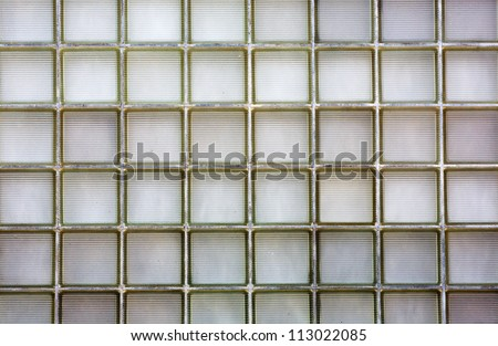 Large wall of ribbed glass brick on an urban home - stock photo