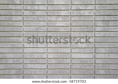 Large wall of white painted bricks taken up close - stock photo