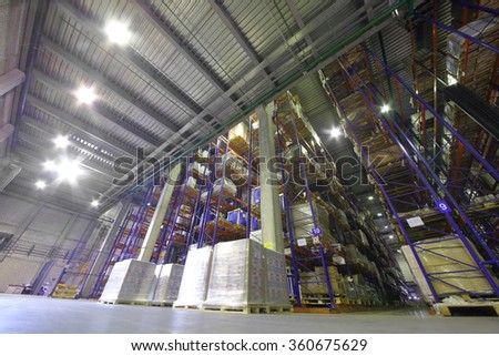 large warehouse with tiered storage of printing products in typographic complex