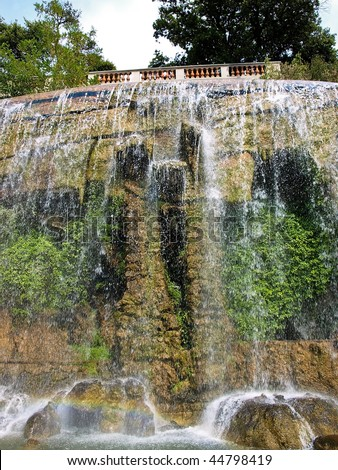 Large waterfall fountain in the La Chateau park in the southern French city of Nice. - stock photo