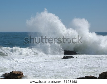 Large wave breaking on Bass Rocks, Gloucester, Ma