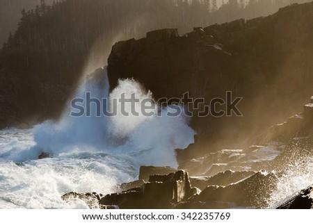 large waves breaking on rocks, Newfoundland, Canada. - stock photo
