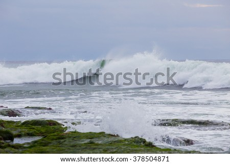 Large waves during a Southern swell at La Jolla Beach in San Diego California. - stock photo