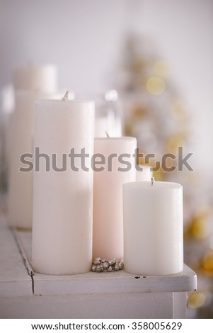 large white candles in the interior. close-up - stock photo