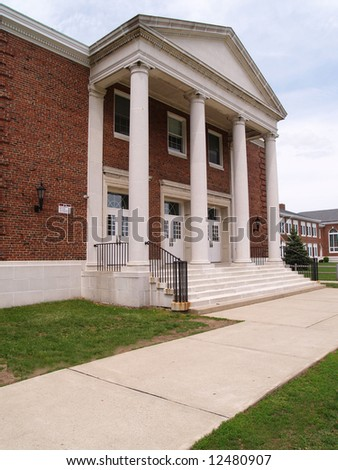 large white columns on the exterior of an old high school in New Jersey - stock photo
