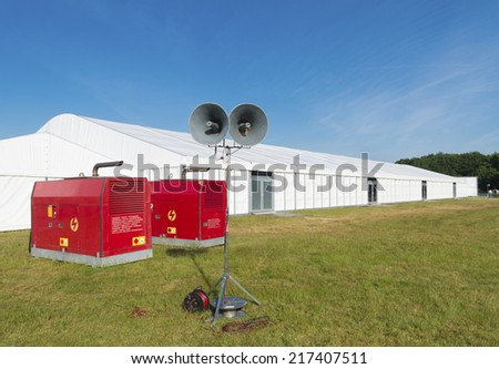 large white event tent with power supply and broadcasting system - stock photo