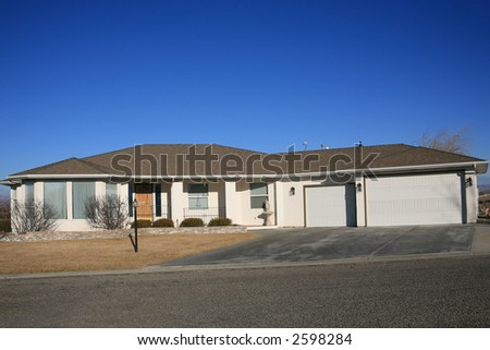 Large white house with three car garage - stock photo