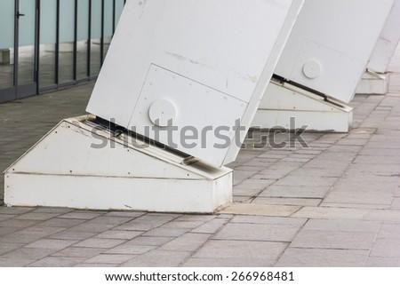 Large white metal columns closeup outdoor - stock photo