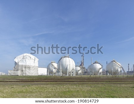large white reservoirs for the petrochemical industry in the rotterdam harbor area - stock photo
