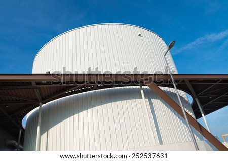 large white storage tank in the rotterdam harbor - stock photo