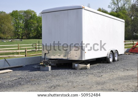 Large white trailer used for hauling and transporting. - stock photo