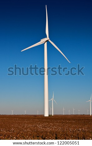 Large Wind Turbine in a Cotton Field with a blue sky background