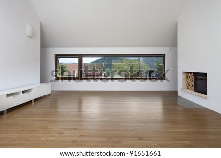 Large window in living room with fireplace - stock photo