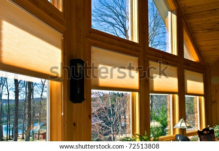 Large windows in a house showing the window treatments. - stock photo
