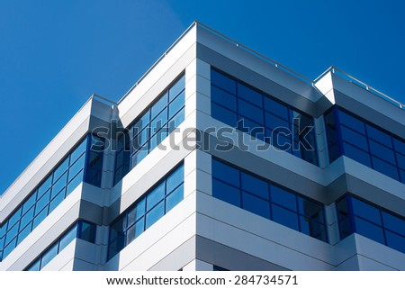 large windows of the new building as a geometric pattern closeup - stock photo