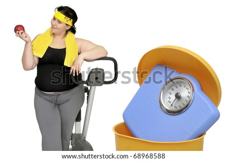 Large woman with an apple and a weight scale in the garbage - stock photo