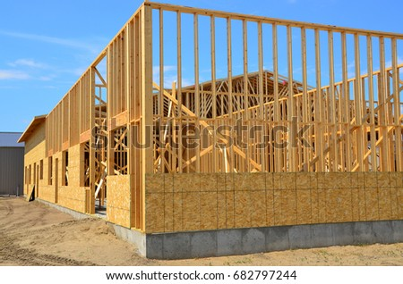 Large Wood Frame Commercial Building Under Stock Photo (100% Legal ...