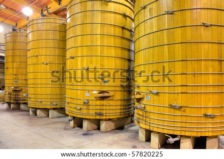 Large Wooden Casks in a California Winery Cellar. - stock photo