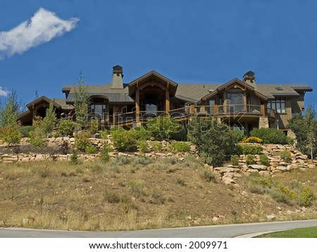 large wooden luxury executive home with decks - stock photo