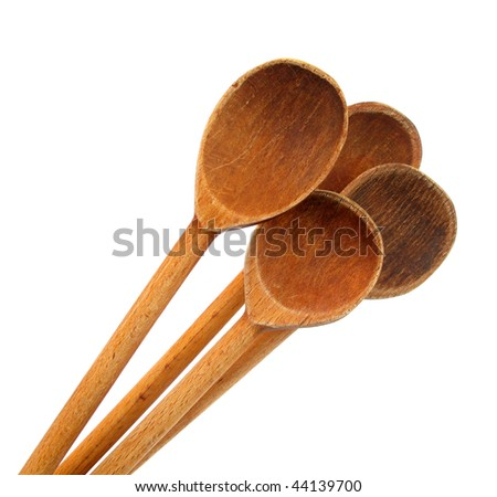 Large wooden mixing spoons - stock photo