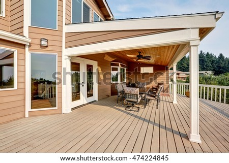 Large Wooden Walkout Deck With Flat Roof Extension And Comfortable Seating  Arrangement. Northwest, USA