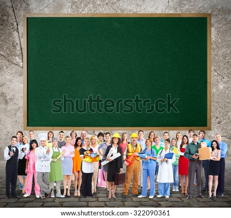 Large Workers People group near blackboard background. - stock photo