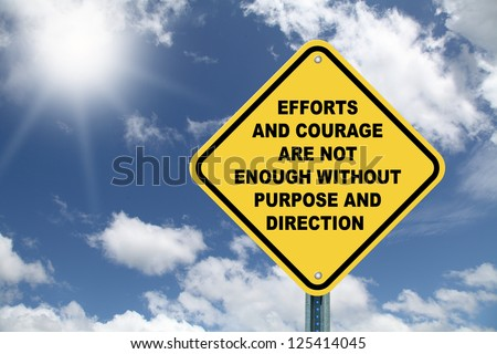 Large Yellow Cautionary Road Sign Efforts and Courage are Not Enough without Purpose and Direction - stock photo