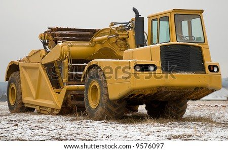 Large yellow earth mover - stock photo