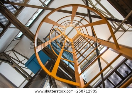 Large yellow ladder in industrial interior Photo