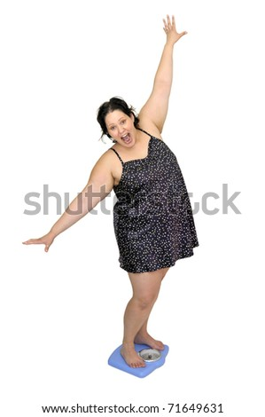 Large young woman in a scale - stock photo
