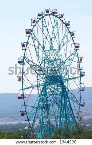 Largest ferris-wheel with opened seats - stock photo