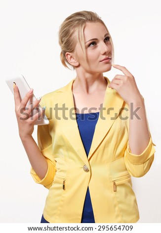 largest white mobile phone, smart business woman thinking what to write in the message - stock photo